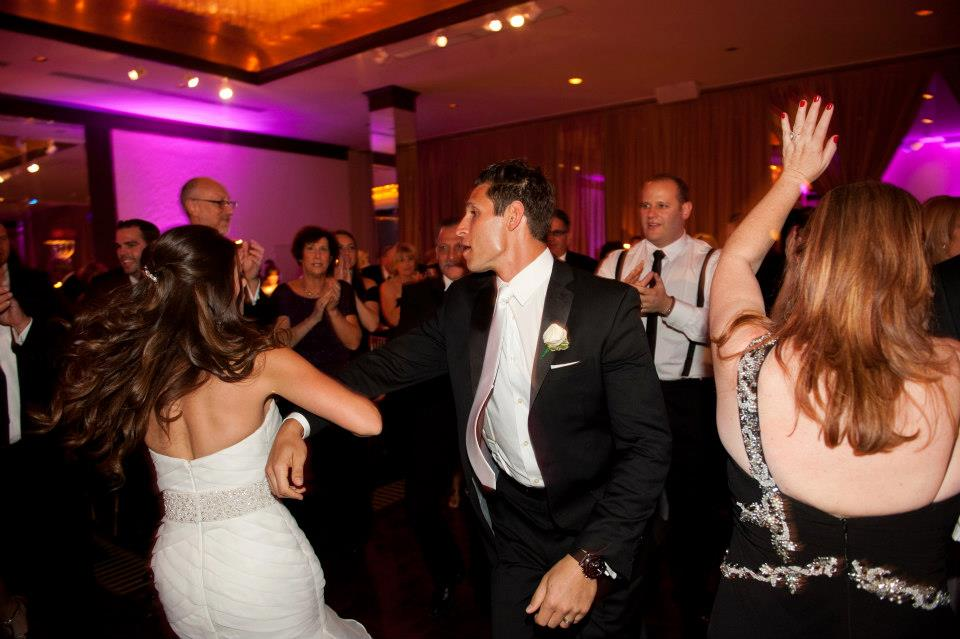 bride and groom dancing the hora