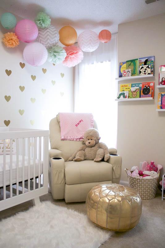 baby girl nursery with paper lantern decor