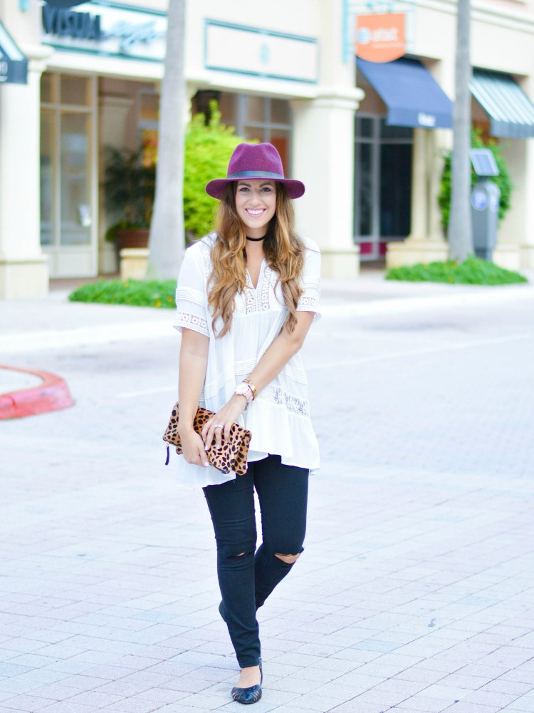Jaime Cittadino of Sunflowers and Stilettos wearing an Anthropologie tiered lace tunic with black skinnies
