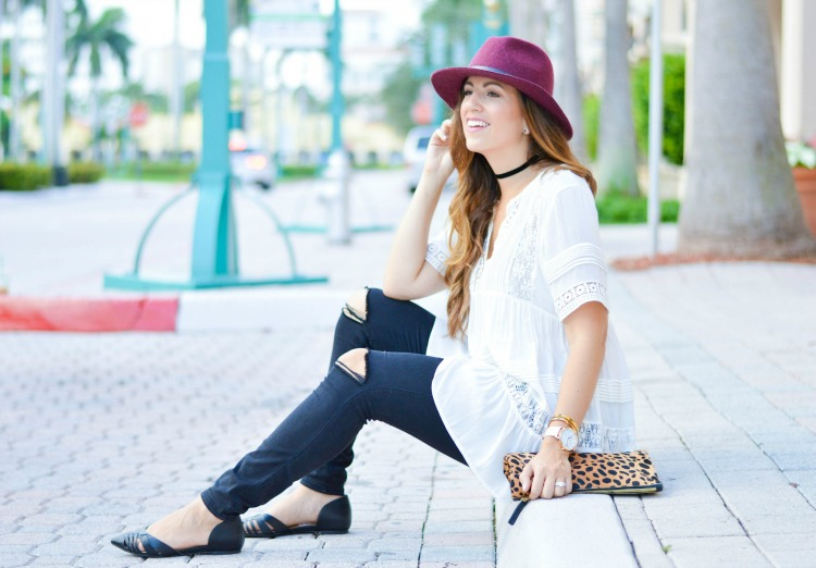 Miami fashion blogger Jaime Cittadino of Sunflowers and Stilettos wearing Clare Vivier leopard clutch and an Anthropologie tunic