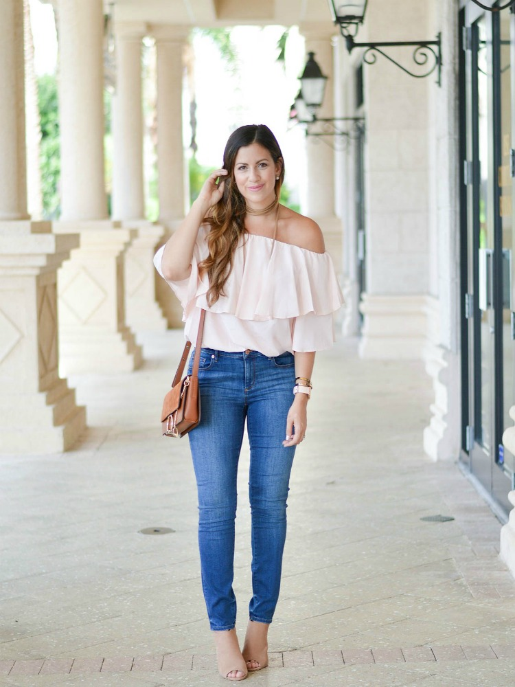 Miami Fashion blogger Jaime Cittadino of Sunflowers and Stilettos wearing a Chicwish pink off shoulder top with jeans and open toe booties for a perfect fall transitional look