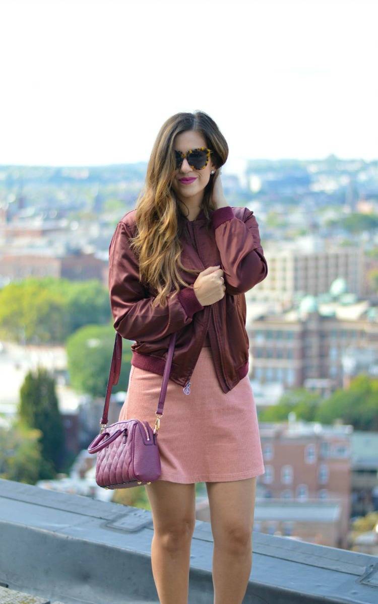 Fashion blogger, Jaime Cittadino of Sunflowers and Stilettos wearing a burgundy satin bomber jacket for fall.
