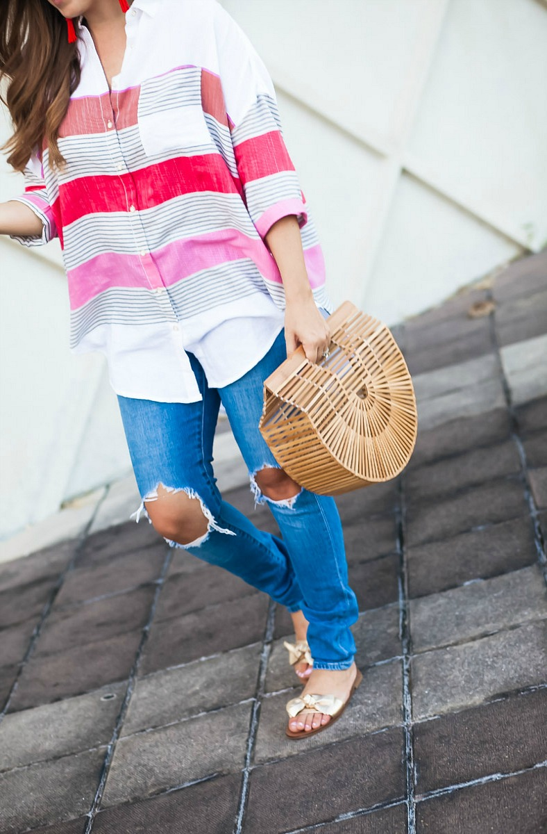oversized stripe button down top _ Cult Gaia bag _ Levi's Distressed Denim Jeans